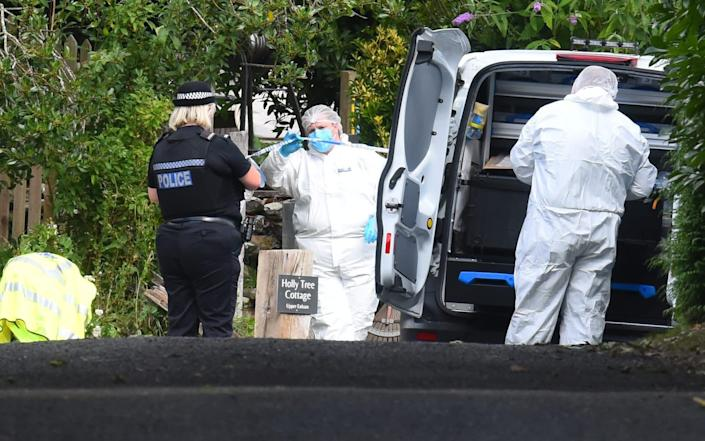 Forensic officers combed the scene - Solent News