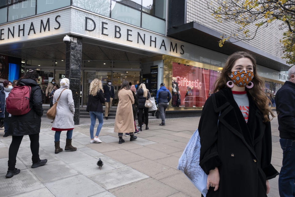 Shoppers queue outside Debenhams on Oxford Street after the department store chain announced it would be closing down for good. Photo: Mike Kemp/In Pictures via Getty