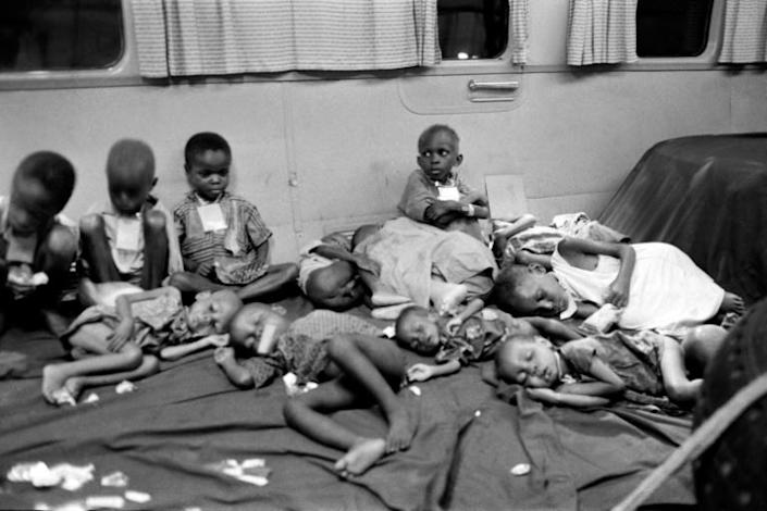 """Biafran children sit in a plane chartered by the International Red Cross (ICRC) and humanitarian organisation """"Terre des Hommes"""" (AFP Photo/Francois Mazure)"""