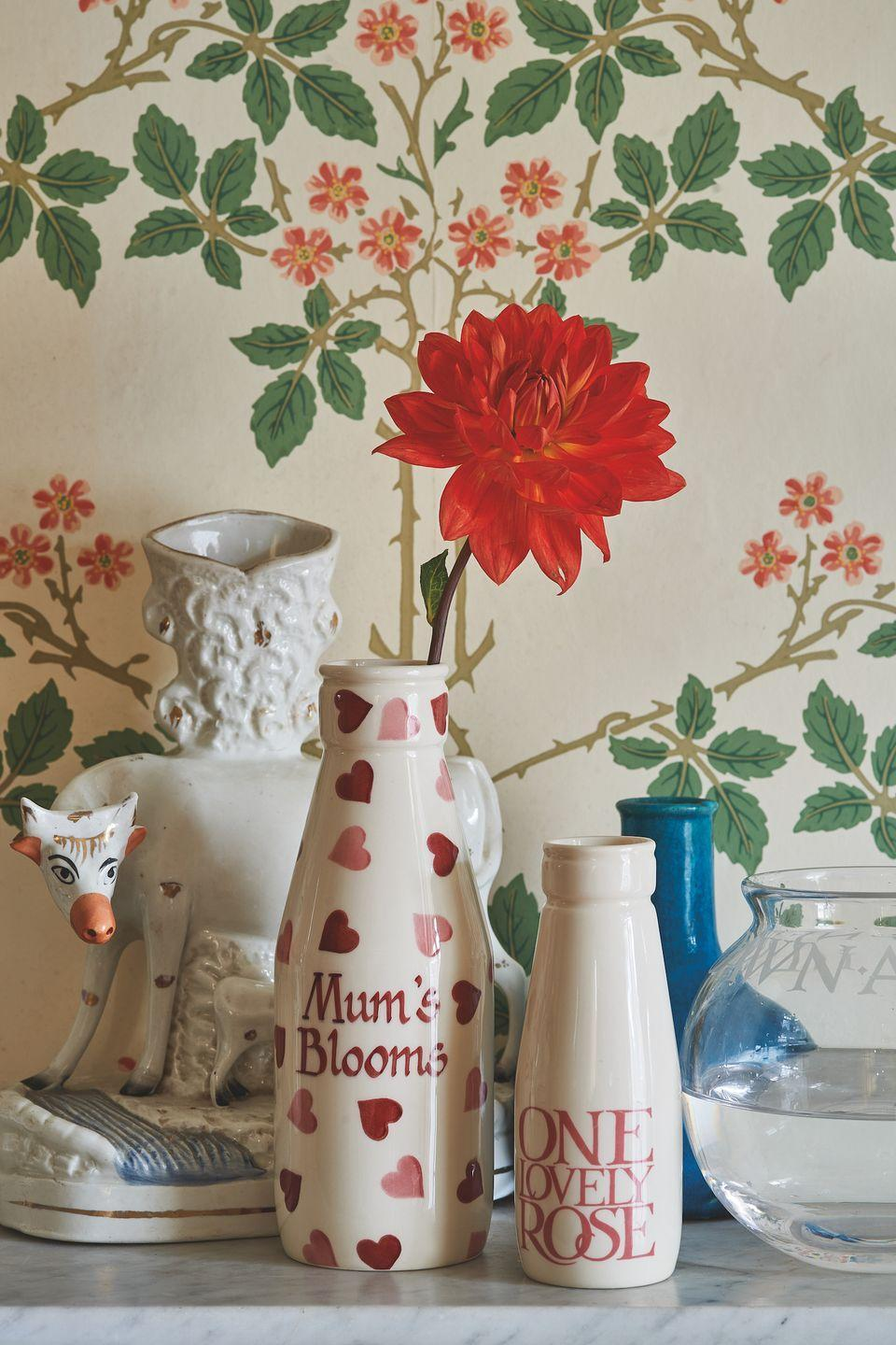 """<p>On the hunt for a Mother's Day must-have? We've got this beautiful 'Mum's Blooms' vase right at the top of our list...</p><p><a class=""""link rapid-noclick-resp"""" href=""""https://go.redirectingat.com?id=127X1599956&url=https%3A%2F%2Fwww.emmabridgewater.co.uk%2Fcollections%2Fnew&sref=https%3A%2F%2Fwww.countryliving.com%2Fuk%2Fhomes-interiors%2Finteriors%2Fg35249240%2Femma-bridgewater-spring%2F"""" rel=""""nofollow noopener"""" target=""""_blank"""" data-ylk=""""slk:BUY NOW"""">BUY NOW</a></p>"""