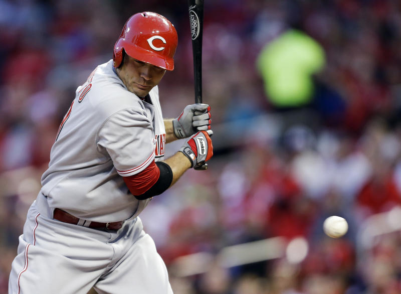 Cincinnati Reds' Joey Votto is hit by a pitch during the first inning of a baseball game against the St. Louis Cardinals on Tuesday, April 8, 2014, in St. Louis. (AP Photo/Jeff Roberson)