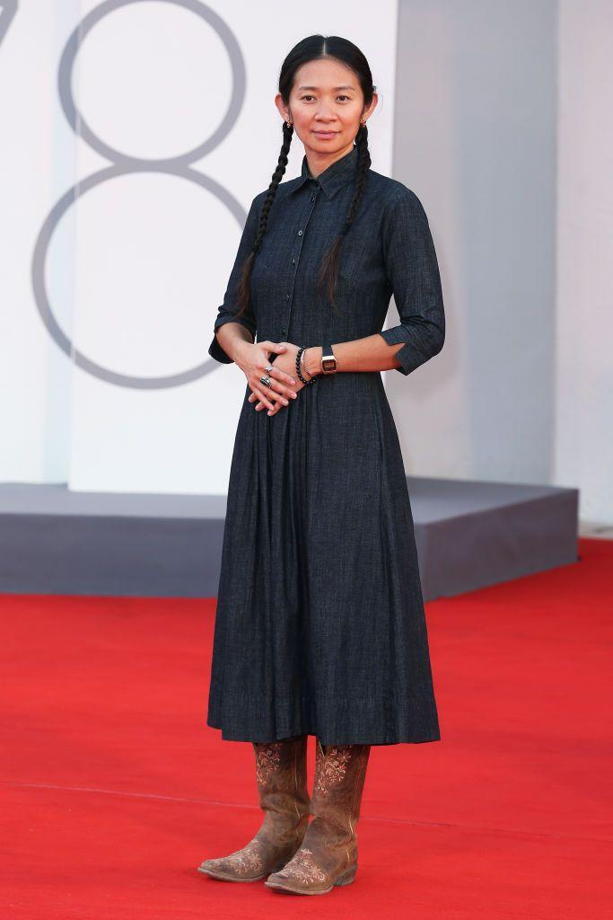 <p>The Oscar-winning director wore a shirt dress and brown knee-high boots to attend the closing ceremony of the 2021 Venice film festival.</p>