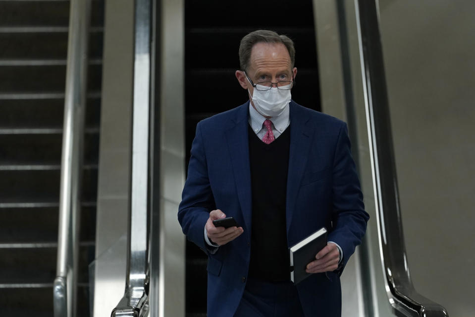Sen. Pat Toomey, R-Pa., walks on Capitol Hill in Washington, Thursday, Feb. 11, 2021, after the third day of the second impeachment trial of former President Donald Trump. (AP Photo/Susan Walsh)