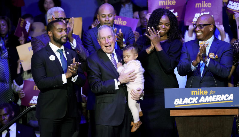 "Democratic presidential candidate and former New York City Mayor Michael Bloomberg, center, is joined on stage by supporters during his campaign launch of ""Mike for Black America,"" at the Buffalo Soldiers National Museum, Thursday, Feb. 13, 2020, in Houston. (AP Photo/David J. Phillip)"
