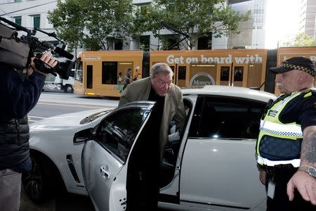 Cardinal George Pell arrives at the Melbourne Magistrates Court