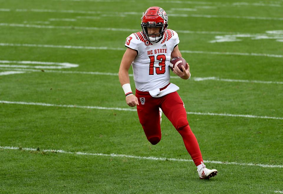 PITTSBURGH, PA - OCTOBER 03: Devin Leary #13 of the North Carolina State Wolfpack in action during the game against the Pittsburgh Panthers at Heinz Field on October 3, 2020 in Pittsburgh, Pennsylvania. (Photo by Justin Berl/Getty Images)