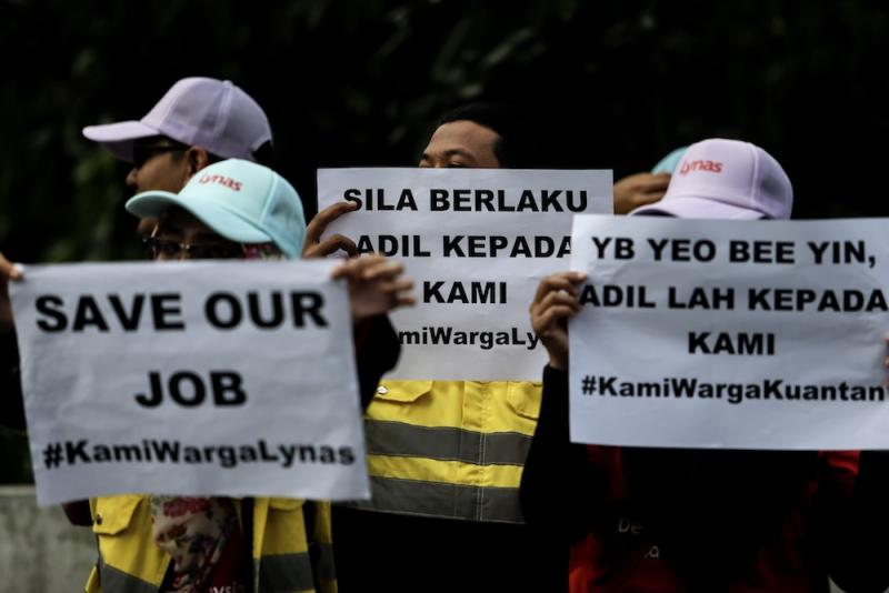 Lynas employees demonstrate in front of the Parliament compound in Kuala Lumpur December 11, 2018. — Picture by Hari Anggara