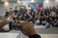 Reporters of Apple Daily take a photo at the headquarters in Hong Kong, Thursday, June 24, 2021. Hong Kong's pro-democracy Apple Daily newspaper will stop publishing Thursday, following last week's arrest of five editors and executives and the freezing of $2.3 million in assets under the city's year-old national security law. (AP Photo/Kin Cheung)