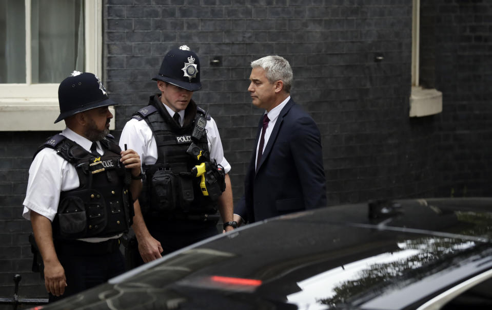 Brexit Secretary Stephen Barclay arrives for a cabinet meeting at 10 Downing Street in London, Monday, Sept. 2, 2019. Prime Minister Boris Johnson has called a meeting of his Cabinet on Monday to weigh a response to the possibility that lawmakers will introduce a measure in House of Commons to block a no-deal Brexit. Speculation abounds that Johnson will call an election soon if he loses the vote in Parliament, but attempt to set a date sometime after the country is set to leave the EU. (AP Photo/Matt Dunham)