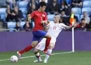 RACIST TWEET EXPULSION: South Korea's Yun Suk-young (L) fights for the ball with Switzerland's Michel Morganella during their men's Group B football match in the London 2012 Olympic Games at the City of Coventry stadium July 29, 2012.