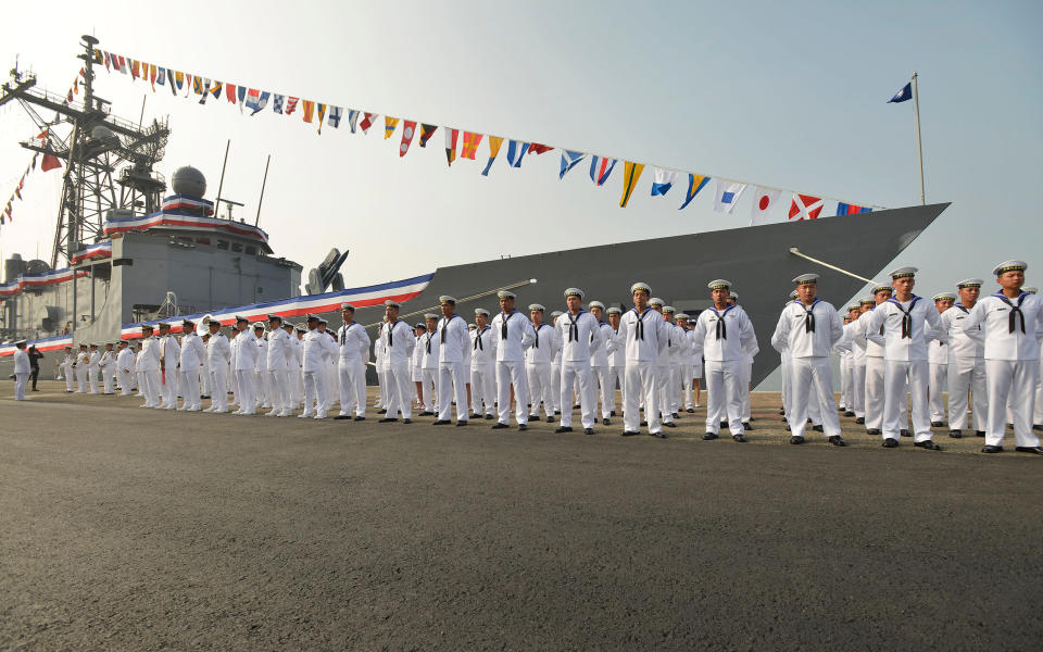 Image: Taiwan sailors parade in front of a new frigate during a ceremony to commission two Perry-class guided missile frigates from the U.S. into the Taiwan Navy, in the southern port of Kaohsiung (Chris Stowers / AFP via Getty Images)