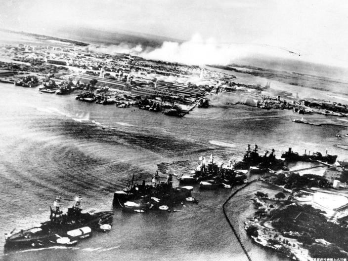 <p>This picture, taken by a Japanese photographer, shows how American ships are clustered together before the surprise Japanese aerial attack on Pear Harbor, HI., on Sunday morning, Dec. 7, 1941. Minutes later the full impact of the assault was felt and Pearl Harbor became a flaming target. (AP Photo) </p>