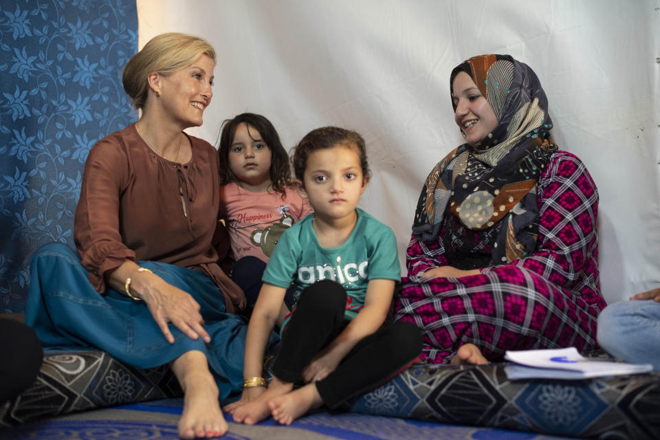 BEKAA VALLEY, LEBANON - JUNE 12: Sophie, Countess of Wessex talks to Asmaa (R) aged 25, and her daughters Sidra, aged 6 (3rd L) and Nisrine, aged 4 (2nd L) on a visit to an informal tented settlement, during the first official Royal visit to the country, on June 12, 2019 in Bekaa Valley, Lebanon. The Countess of Wessex announced her commitment to supporting the UK's efforts in the Women, Peace and Security agenda (WPS), and the Preventing Sexual Violence in Conflict Initiative (PSVI) earlier this year. (Photo by Victoria Jones - WPA Pool/Getty Images)
