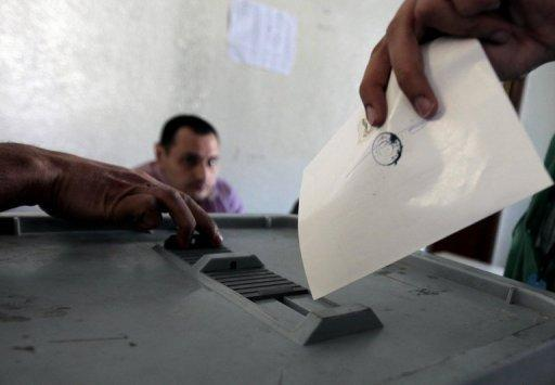 A Syrian voter casts his ballot for the parliamentary elections