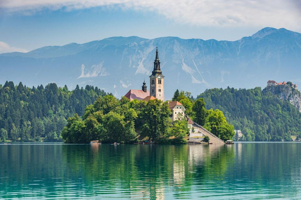 """<p>Lake Bled is probably the first place that springs to mind when you think of <a href=""""https://www.countrylivingholidays.com/tours/lake-bled-slovenia-munich-walking-tour"""" rel=""""nofollow noopener"""" target=""""_blank"""" data-ylk=""""slk:Slovenia"""" class=""""link rapid-noclick-resp"""">Slovenia</a>. This serene glacial lake captivates travellers throughout the seasons and is undeniably beautiful – but only one of Slovenia's many beauty spots.</p><p>If you're a fan of <a href=""""https://www.countryliving.com/uk/travel-ideas/abroad/a29189708/lake-mountain-holidays/"""" rel=""""nofollow noopener"""" target=""""_blank"""" data-ylk=""""slk:lakes and mountain holidays"""" class=""""link rapid-noclick-resp"""">lakes and mountain holidays</a>, Slovenia is a dream and is packed with natural sights to soak up.</p><p><a class=""""link rapid-noclick-resp"""" href=""""https://www.countrylivingholidays.com/tours/lake-bled-slovenia-munich-walking-tour"""" rel=""""nofollow noopener"""" target=""""_blank"""" data-ylk=""""slk:VISIT BLED WITH COUNTRY LIVING"""">VISIT BLED WITH COUNTRY LIVING</a></p><p>The tiny country that sits in the heart of Europe is characterised by its blue lakes, endless mountains and charming towns. Its capital city Ljubljana is one one of the greenest cities in Europe, while the striking Julian Alps dazzles with its peak Mt Triglav and lovely Lake Bohinj (which, in our opinion, is just as charming as Bled).</p><p>During a holiday to Slovenia, <a href=""""https://www.countryliving.com/uk/travel-ideas/staycation-uk/a35921275/best-walking-holidays-uk/"""" rel=""""nofollow noopener"""" target=""""_blank"""" data-ylk=""""slk:walking"""" class=""""link rapid-noclick-resp"""">walking</a> is a must, while cycling and getting around by coach or train are other ways to explore the compact country. </p><p>From outstanding lake views to picturesque waterfalls, Slovenia has plenty to entertain lovers of nature. In fact, you can get to know the country's best bits when travel restrictions are lifted by joining <a href=""""https://www.countrylivingholidays.com/tours/lake-bled-sloven"""