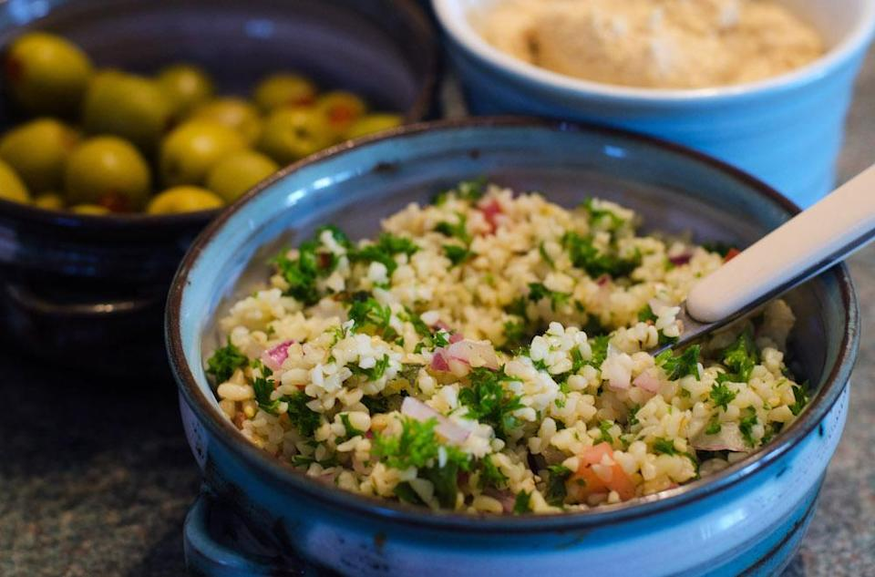 """<p>You may think couscous comes out of a packet you buy in the supermarket. But how about getting inspired by a classic Middle Eastern Tabbouleh salad made of bulgar wheat, tomatoes, parsley, mint, onion and garlic with loads of zingy seasoning. Try <a rel=""""nofollow noopener"""" href=""""https://www.deliaonline.com/recipes/collections/delias-summer-collection/middle-eastern-tabbouleh-salad"""" target=""""_blank"""" data-ylk=""""slk:Delia Smith's recipe here"""" class=""""link rapid-noclick-resp"""">Delia Smith's recipe here</a> to get you started. [Photo: Rex] </p>"""