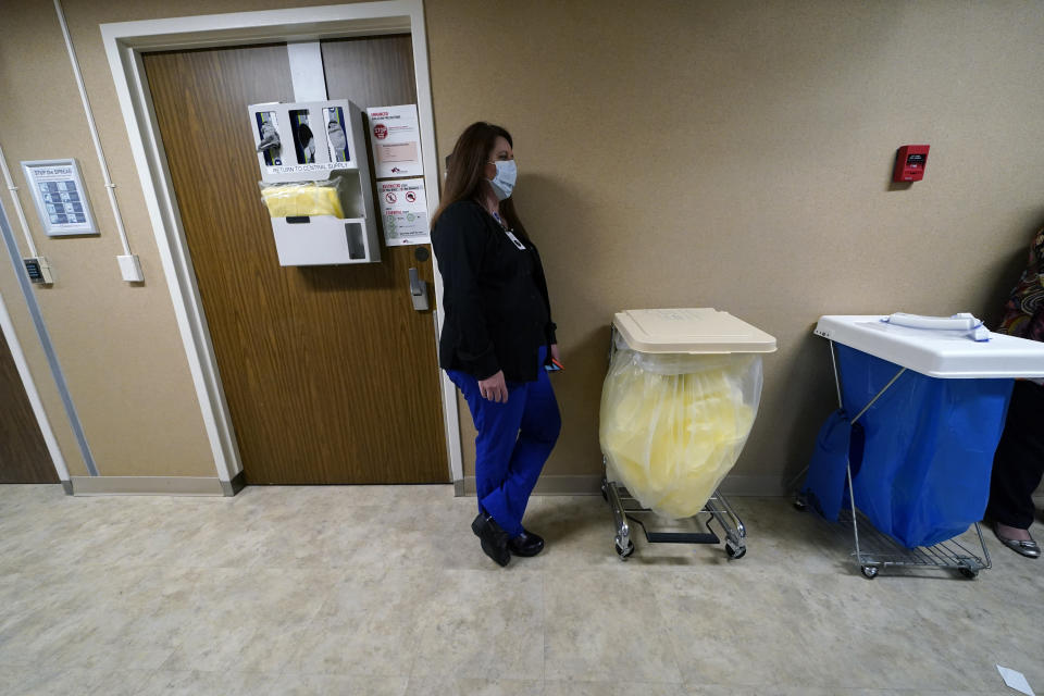 Denise Jones, a registered nurse, pauses in a hallway after a COVID-19 patient died, at at the Willis-Knighton Medical Center in Shreveport, La., Wednesday, Aug. 18, 2021. (AP Photo/Gerald Herbert)