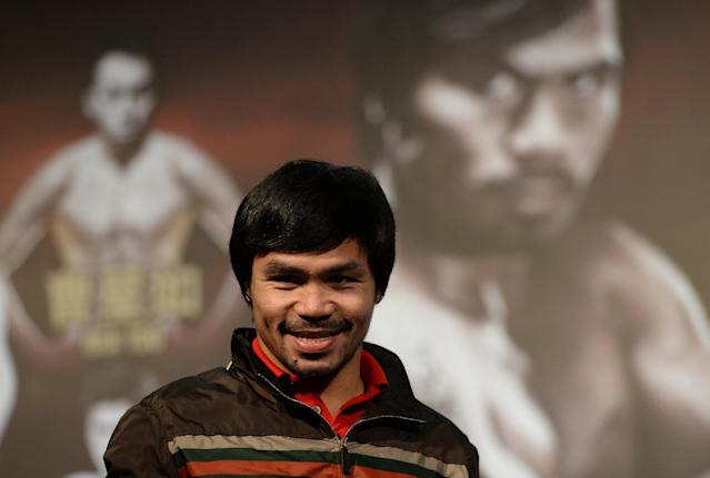 Philippine boxing icon Manny Pacquiao attends a pre-fight press conference in Macau, on August 25, 2014 (AFP Photo/Dale de la Rey)