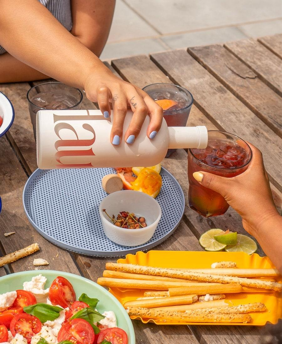 """Low-proof aperitifs are having a moment, and for your friends who appreciate <a href=""""https://www.glamour.com/story/picnic-essentials?mbid=synd_yahoo_rss"""" rel=""""nofollow noopener"""" target=""""_blank"""" data-ylk=""""slk:an alfresco hang"""" class=""""link rapid-noclick-resp"""">an alfresco hang</a>, introduce them to <a href=""""https://www.glamour.com/story/haus-aperitif-review?mbid=synd_yahoo_rss"""" rel=""""nofollow noopener"""" target=""""_blank"""" data-ylk=""""slk:Haus."""" class=""""link rapid-noclick-resp"""">Haus.</a> It's the grown-up refreshment missing from their bar cart. $35, Haus. <a href=""""https://drink.haus/products/ginger-yuzu?variant=31737549946932"""" rel=""""nofollow noopener"""" target=""""_blank"""" data-ylk=""""slk:Get it now!"""" class=""""link rapid-noclick-resp"""">Get it now!</a>"""