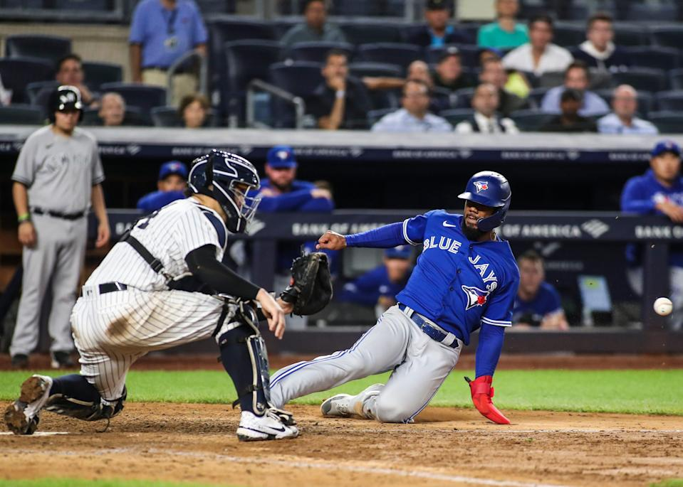 The Blue Jays' Teoscar Hernandez slides in ahead of the tag by Yankees catcher Gary Sanchez in Thursday's 6-4 Toronto win.