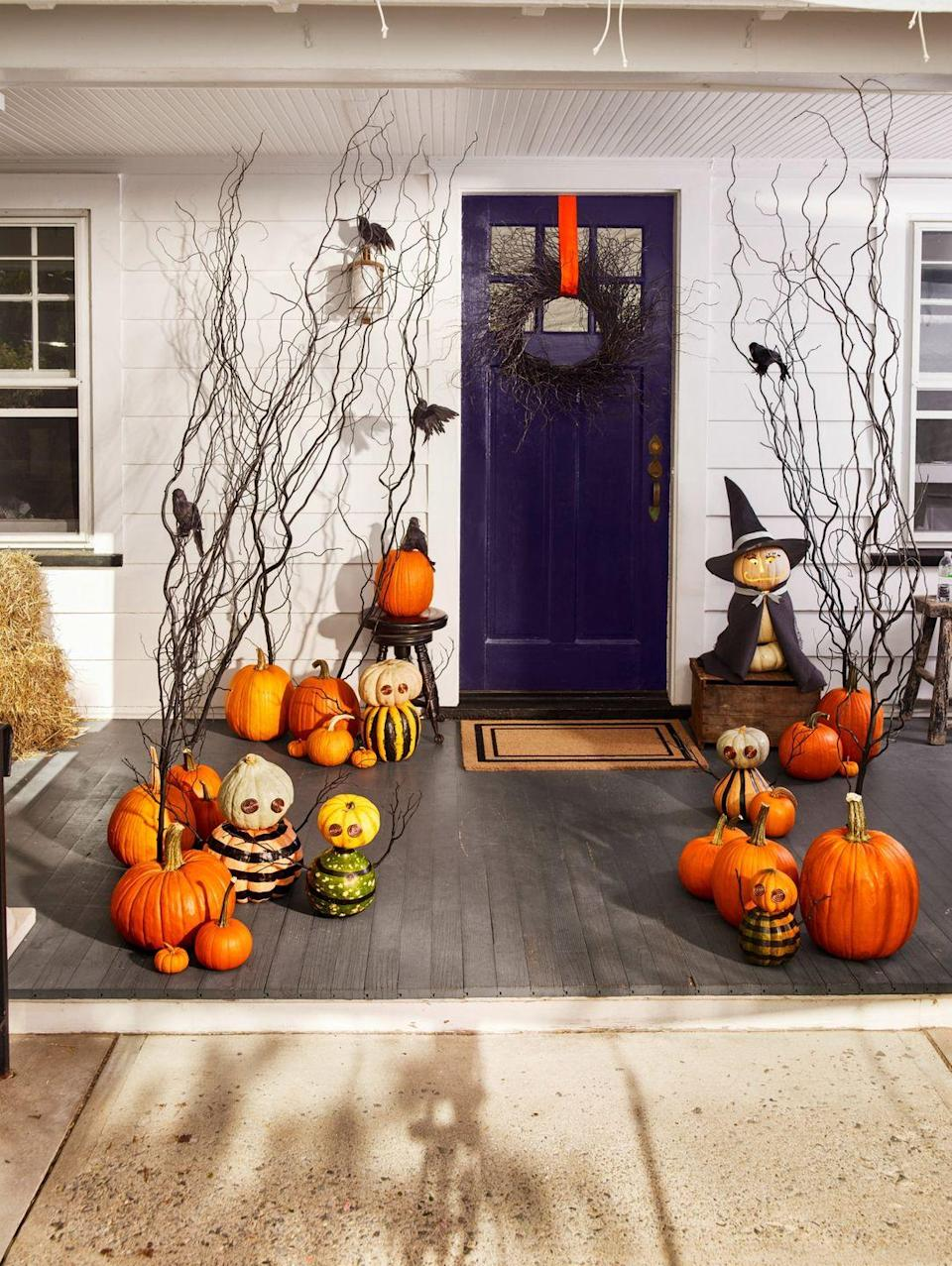 """<p>Coiled aluminum-wire eyes that reflect light are a reminder that this ragtag team of ghouls is keeping watch over your house. Paint the body in your favorite patterns, stack a smaller pumpkin on top for the head, and add sticks for arms. </p><p><strong>What You'll Need:</strong> <a href=""""https://www.amazon.com/BENECREAT-Aluminum-Anodized-Jewelry-Beading/dp/B0752D6NKD/ref=redir_mobile_desktop?ie=UTF8&aaxitk=Oip9pha8iZHEN-j0yDUUcQ&hsa_cr_id=3934383830101&ref_=sbx_be_s_sparkle_mcd_asin_1&tag=syn-yahoo-20&ascsubtag=%5Bartid%7C10070.g.1279%5Bsrc%7Cyahoo-us"""" rel=""""nofollow noopener"""" target=""""_blank"""" data-ylk=""""slk:Aluminum wire"""" class=""""link rapid-noclick-resp"""">Aluminum wire</a> ($14, Amazon); <a href=""""https://www.amazon.com/Zenacolor-Acrylic-Painting-Supplies-Children/dp/B07PPTRFPL/ref=sr_1_1_sspa?dchild=1&keywords=acrylic+paint&qid=1594916836&sr=8-1-spons&psc=1&spLa=ZW5jcnlwdGVkUXVhbGlmaWVyPUEzQUFPMVA4NkZTMENSJmVuY3J5cHRlZElkPUEwODgzMjkzMzBZTkFDRVdYQkQ5UyZlbmNyeXB0ZWRBZElkPUEwNTQ1Nzg1M0ZOUklUQVdQUTZWSyZ3aWRnZXROYW1lPXNwX2F0ZiZhY3Rpb249Y2xpY2tSZWRpcmVjdCZkb05vdExvZ0NsaWNrPXRydWU%3D&tag=syn-yahoo-20&ascsubtag=%5Bartid%7C10070.g.1279%5Bsrc%7Cyahoo-us"""" rel=""""nofollow noopener"""" target=""""_blank"""" data-ylk=""""slk:acrylic paint"""" class=""""link rapid-noclick-resp"""">acrylic paint</a> ($30, Amazon)</p>"""