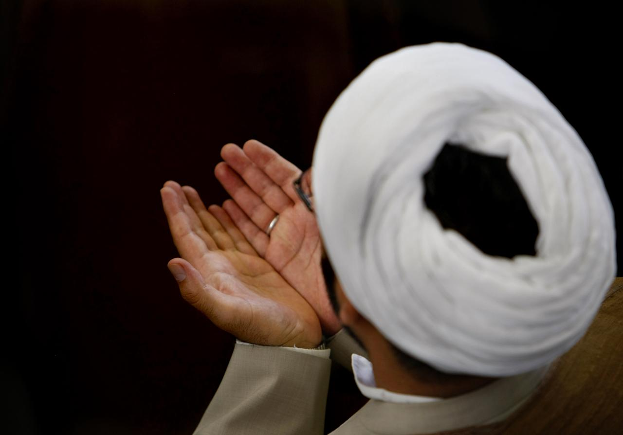 An Iranian clergyman performs the weekly noon prayer at Tehran university on the first Friday of the holy month of Ramadan, on September 5, 2008. Muslims across the world are observing the holy month of Ramadan, the ninth and holiest month of the Muslim calendar, which is traditionally determined by the sighting of a new crescent moon. Practicing Muslims desist from eating, drinking, smoking and any sexual activities from dawn to dusk during Ramadan.  AFP PHOTO/BEHROUZ MEHRI