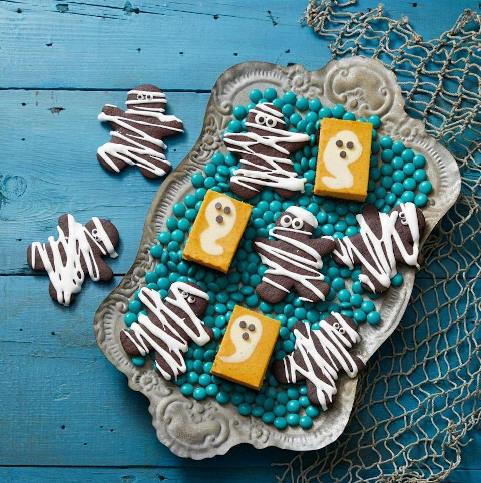 """<p>Some of the cheesecake filling gets flavored with pumpkin puree, while some is saved to dollop on top and create (friendly!) ghosts.</p><p><em><a href=""""https://www.womansday.com/food-recipes/a33562053/pumpkin-cheesecake-ghosts-recipe/"""" rel=""""nofollow noopener"""" target=""""_blank"""" data-ylk=""""slk:Get the recipe from Woman's Day »"""" class=""""link rapid-noclick-resp"""">Get the recipe from Woman's Day »</a></em></p><p><strong>RELATED: </strong><a href=""""https://www.goodhousekeeping.com/food-recipes/dessert/g4454/pumpkin-cheesecake-recipes/"""" rel=""""nofollow noopener"""" target=""""_blank"""" data-ylk=""""slk:22 Easy Pumpkin Cheesecake Recipes to Make This Fall"""" class=""""link rapid-noclick-resp"""">22 Easy Pumpkin Cheesecake Recipes to Make This Fall</a><br></p>"""
