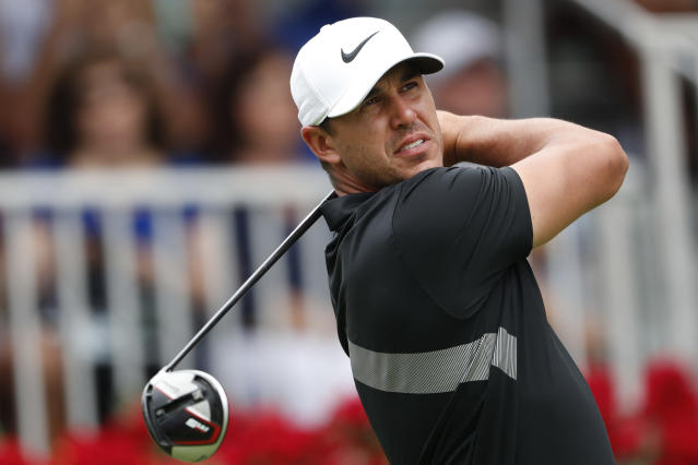 FILE - In this Aug. 25, 2019, file photo, Brooks Koepka hits from the first tee during the final round of the Tour Championship golf tournament at East Lake Golf Club in Atlanta. Koepka and Rory McIlroy are being talked about as rivals because they've had the best year in golf.(AP Photo/John Bazemore, File)