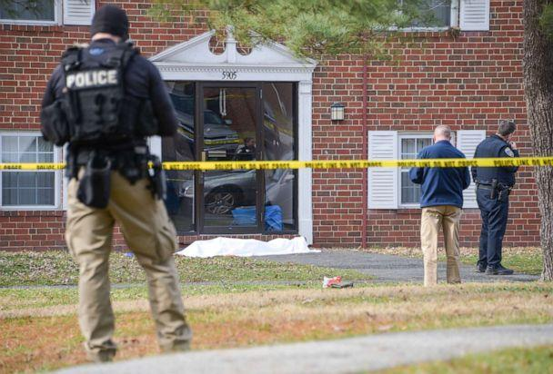 PHOTO: Law enforcement personnel work at the scene which appears to show a body covered under a white blanket outside of an apartment, Wednesday, Feb. 12, 2020, in Baltimore. (Ulysses Munoz/The Baltimore Sun via AP)