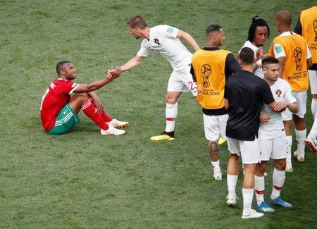 Soccer Football - World Cup - Group B - Portugal vs Morocco - Luzhniki Stadium, Moscow, Russia - June 20, 2018 Portugal's Adrien Silva shakes hands with Morocco's Ayoub El Kaabi after the match REUTERS/Christian Hartmann
