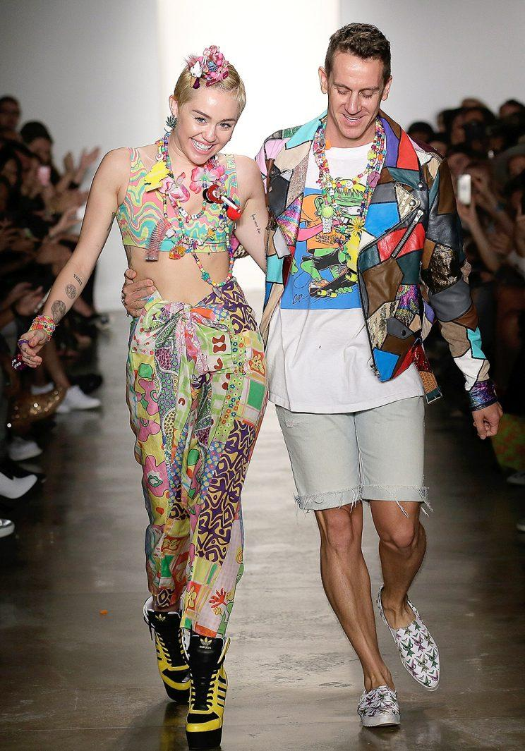 Designer Jeremy Scott walked the runway at a show Miley accessorized. (Photo: Randy Brooke/WireImage)