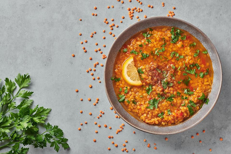"""<p>If you're looking to eat less meat, try this hearty soup. Red lentil soup will help you squeeze in extra <a href=""""https://www.thedailymeal.com/cook/10-protein-packed-vegetables-slideshow?referrer=yahoo&category=beauty_food&include_utm=1&utm_medium=referral&utm_source=yahoo&utm_campaign=feed"""" rel=""""nofollow noopener"""" target=""""_blank"""" data-ylk=""""slk:protein"""" class=""""link rapid-noclick-resp"""">protein</a> without meat. For a creamy consistency, you can add coconut milk to the soup.</p> <p><a href=""""https://www.thedailymeal.com/recipes/slow-cooker-red-lentil-soup?referrer=yahoo&category=beauty_food&include_utm=1&utm_medium=referral&utm_source=yahoo&utm_campaign=feed"""" rel=""""nofollow noopener"""" target=""""_blank"""" data-ylk=""""slk:For the Slow Cooker Red Lentil Soup recipe, click here."""" class=""""link rapid-noclick-resp"""">For the Slow Cooker Red Lentil Soup recipe, click here.</a></p>"""