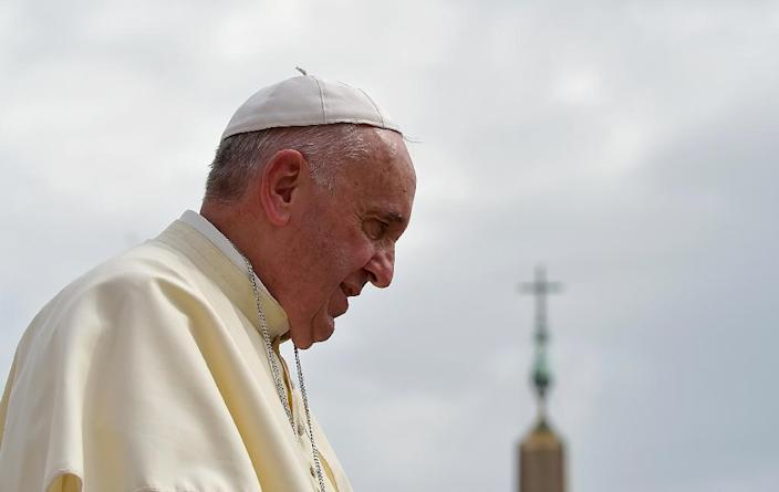 Pope Francis has called for every European parish to take in a refugee family (AFP Photo/Vincenzo Pinto)