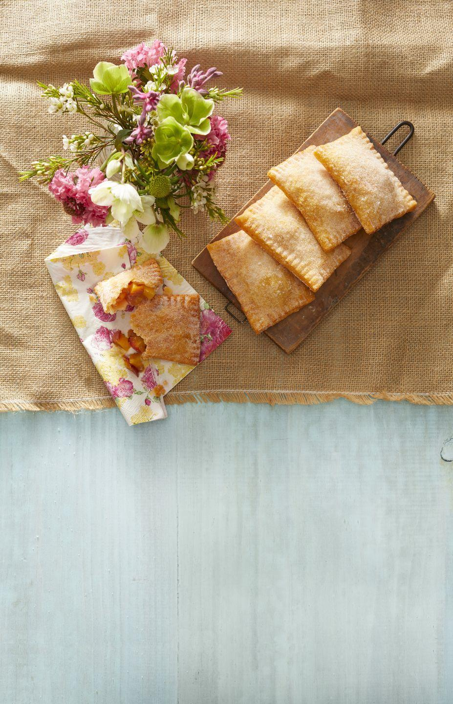 """<p>Ree's peach hand pies are just the cutest summer dessert. The ground ginger gives them a delicious extra kick too. </p><p><a href=""""https://www.thepioneerwoman.com/food-cooking/recipes/a32097059/fried-peach-ginger-hand-pies-recipe/"""" rel=""""nofollow noopener"""" target=""""_blank"""" data-ylk=""""slk:Get Ree's recipe."""" class=""""link rapid-noclick-resp""""><strong>Get Ree's recipe</strong>. </a> </p><p><a class=""""link rapid-noclick-resp"""" href=""""https://go.redirectingat.com?id=74968X1596630&url=https%3A%2F%2Fwww.walmart.com%2Fsearch%2F%3Fquery%3Dpioneer%2Bwoman%2Bserving%2Bplates&sref=https%3A%2F%2Fwww.thepioneerwoman.com%2Ffood-cooking%2Frecipes%2Fg36382592%2Fpeach-desserts%2F"""" rel=""""nofollow noopener"""" target=""""_blank"""" data-ylk=""""slk:SHOP SERVING PLATES"""">SHOP SERVING PLATES</a></p>"""
