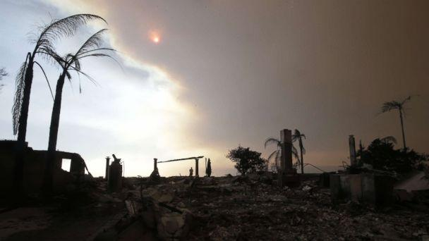 PHOTO: A man walks among the ruins of a home destroyed by the Thomas Fire as smoke obscures the sky in Ventura, Calif., Dec. 6, 2017. (Mike Nelson/EPA)
