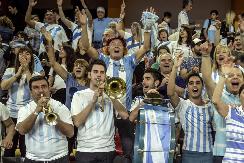 Fans of Argentina cheer during a Davis Cup World Group play-off tennis match between Argentina and Colombia in San Juan, Argentina, Saturday, Sept. 15, 2018. (AP Photo/Sergio Llamera)