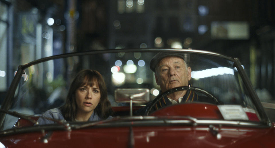 """This image released by Apple shows Bill Murray, right, and Rashida Jones in a scene from """"On the Rocks."""" (Apple via AP)"""