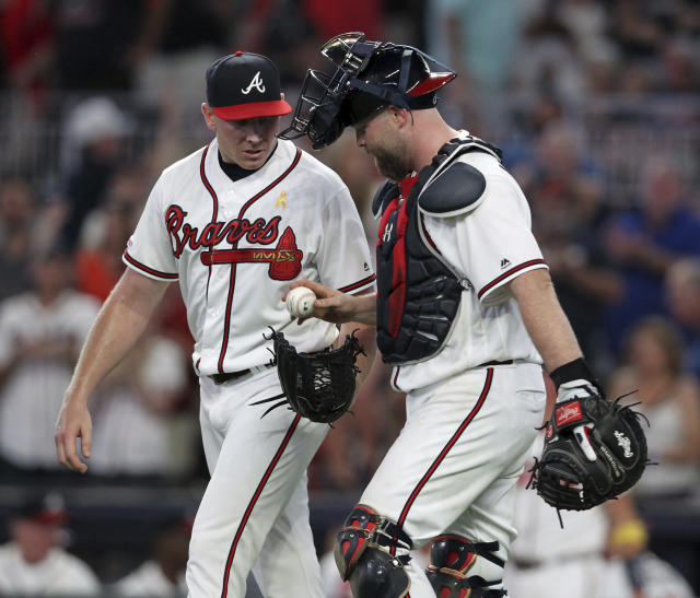 Atlanta Braves relief pitcher Mark Melancon, left, celebrates with catcher Brian McCann after their win over the Washington Nationals in a baseball game Saturday, Sept. 7, 2019, in Atlanta. (AP Photo/Tami Chappell)