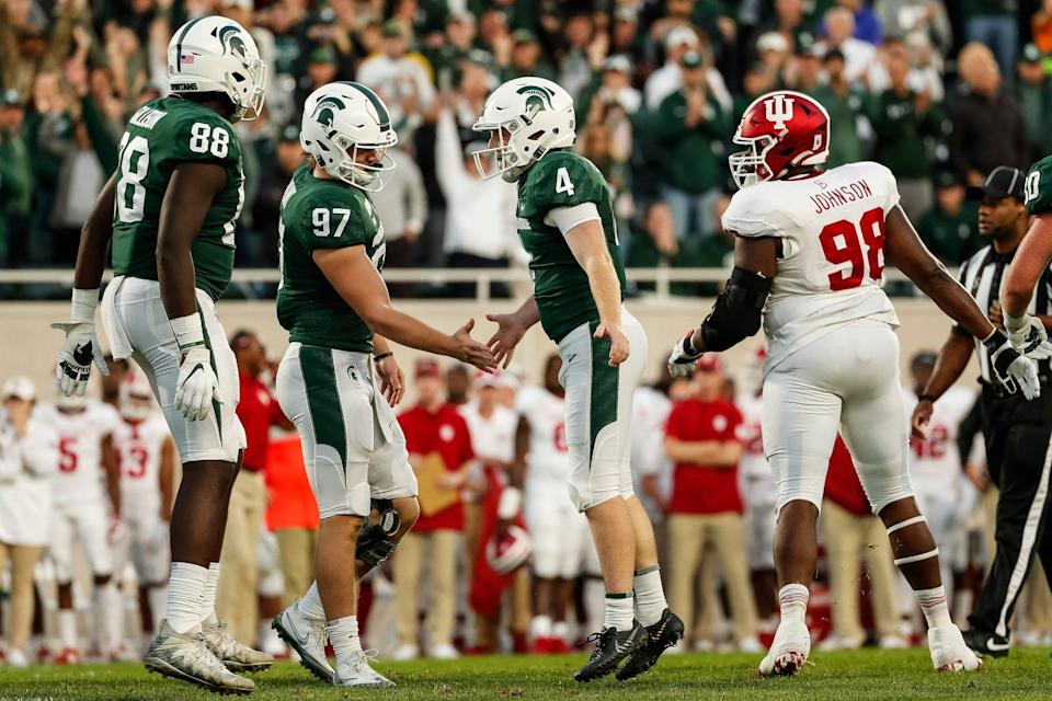 Michigan State tight ends Tyler Hunt (97) and Trenton Gillison (88) celebrate a 2019 field goal with kicker Matt Coghlin (4).