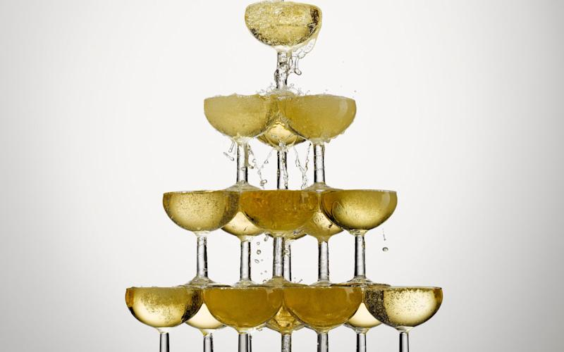 Champagne pouring into stacked glasses - Andy Roberts/OJO Images RF