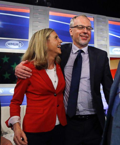 PHOTO: Levi Sanders, right, shares a laugh with Maura Sullivan following a debate for Democratic hopefuls in New Hampshire's 1st Congressional District at the Institute of Politics at St. Anselm College in Manchester, N.H., Sept. 5, 2018. (Charles Krupa/AP)