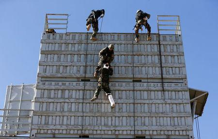Afghan army Special Forces take part in a military exercise in Rishkhur district outside Kabul