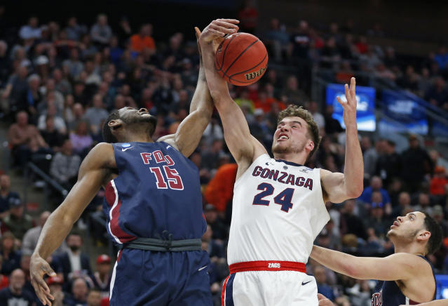 Gonzaga forward Corey Kispert (24) and Fairleigh Dickinson center Oscar Okeke (15) vie for control of a rebound during the first half of a first-round game in the NCAA mens college basketball tournament Thursday, March 21, 2019, in Salt Lake City. (AP Photo/Rick Bowmer)