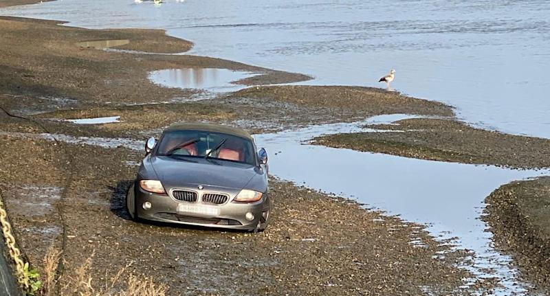 James Roycroft-Davis, 25, could only watch as his BMW Z4 floated away. (SWNS)