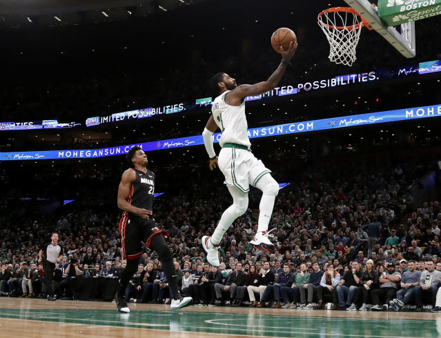 """<a class=""""link rapid-noclick-resp"""" href=""""/nba/players/4840/"""" data-ylk=""""slk:Kyrie Irving"""">Kyrie Irving</a> dropped 26 points and 10 assists on Monday night to lead the <a class=""""link rapid-noclick-resp"""" href=""""/nba/teams/boston/"""" data-ylk=""""slk:Boston Celtics"""">Boston Celtics</a> past the <a class=""""link rapid-noclick-resp"""" href=""""/nba/teams/miami/"""" data-ylk=""""slk:Miami Heat"""">Miami Heat</a> for their fourth straight win. (AP/Winslow Townson)"""