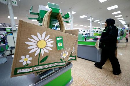 FILE PHOTO: Shopping bags are displayed at the Asda superstore in High Wycombe, Britain, February 8, 2017.  REUTERS/Eddie Keogh/File Photo