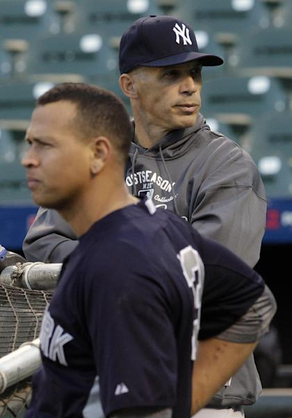FILE - In this Oct. 6, 2012 file photo, New York Yankees manager Joe Girardi, right, and third baseman Alex Rodriguez take part in baseball practice in Baltimore. Girardi says the length of Rodriguez's grievance hearing complicates the team's offseason planning. The players' association is trying to overturn a 211-game suspension given to the third baseman last August for alleged violations of baseball's drug program and labor contract. Girardi said Thursday, Nov. 7, 2013, that if a decision isn't made soon, the team will have to make backup third base plans in case Rodriguez isn't available. (AP Photo/Patrick Semansky, File)