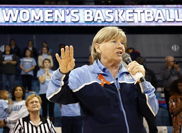North Carolina head coach Sylvia Hatchell addresses the crowd at halftime of an NCAA women's college basketball game against Maryland, Sunday, Jan. 5, 2014, in Chapel Hill, N.C. The Hall of Fame coach has been out all year while she receives treatment for leukemia. (AP Photo/Ellen Ozier)