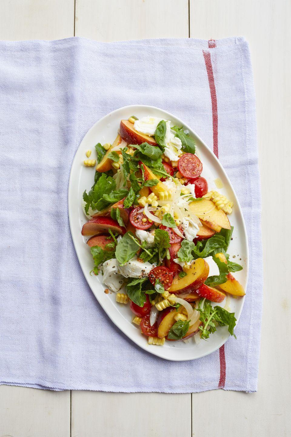 "<p>Fresh peaches add a new layer of flavor to typical caprese.</p><p><a href=""https://www.womansday.com/food-recipes/food-drinks/recipes/a55295/peach-caprese-salad-recipe/"" rel=""nofollow noopener"" target=""_blank"" data-ylk=""slk:Get the Peach Caprese Salad recipe."" class=""link rapid-noclick-resp""><em>Get the Peach Caprese Salad recipe.</em></a> </p>"
