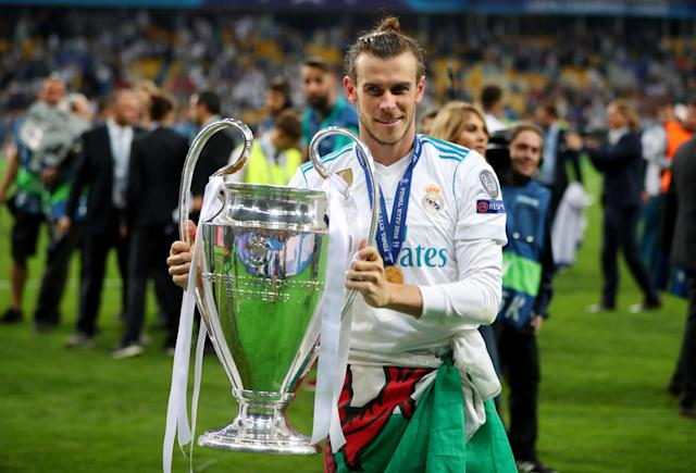 Soccer Football - Champions League Final - Real Madrid v Liverpool - NSC Olympic Stadium, Kiev, Ukraine - May 26, 2018 Real Madrid's Gareth Bale celebrates winning the Champions League with the trophy REUTERS/Hannah McKay